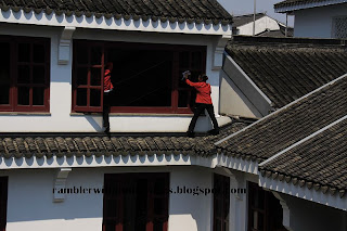 Hotel staff cleaning windows, Wugong, Pan Pacific Hotel, Suzhou, China