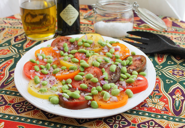 Food Lust People Love: The combination of vine-ripened tomatoes, along with a sprinkling of shelled edamame, makes this a fabulous fresh salad full of the flavors of summer. Sometimes the simplest salads are the best.
