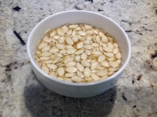 bowl of pumpkin seeds soaking