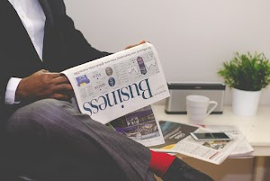 Business man reading newspaper