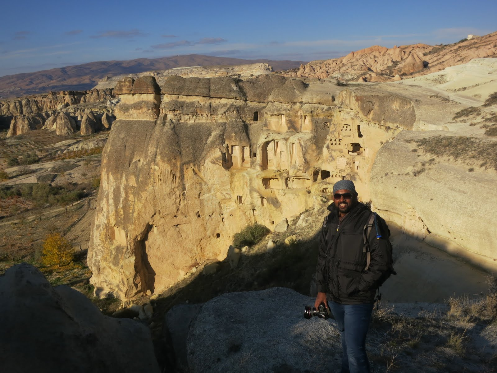 Posing in front of the Cappadocia ancient living quarters