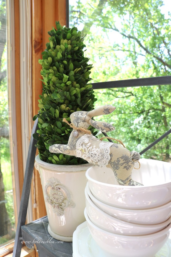 French country Easter plate stand with a brown toile bunny