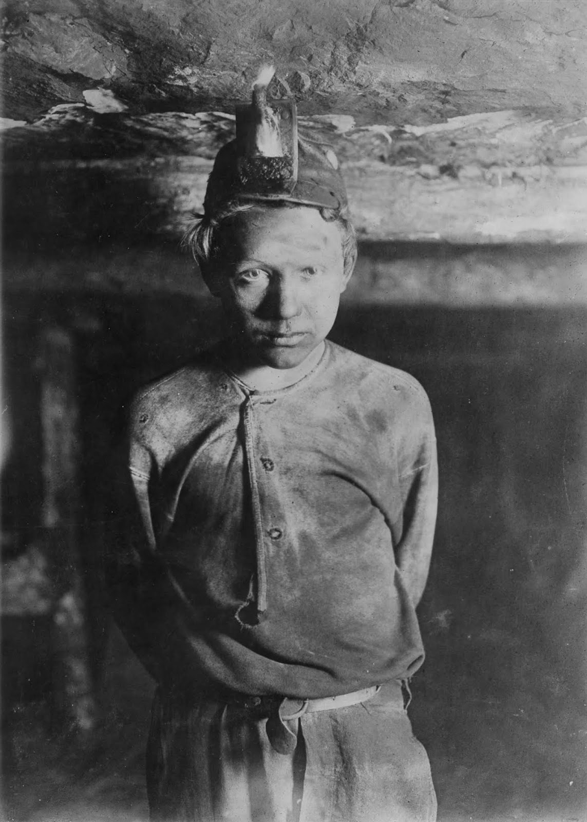 A trapper boy, one mile inside Turkey Knob Mine in Macdonald, West Virginia. 1908.