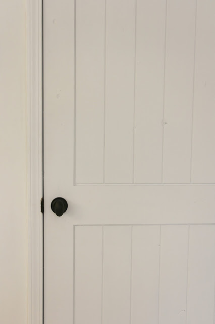 image result for Pacific Entries knotty alder door painted white