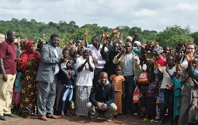Representatives from Tostan and the Government with community members in Koobèn.