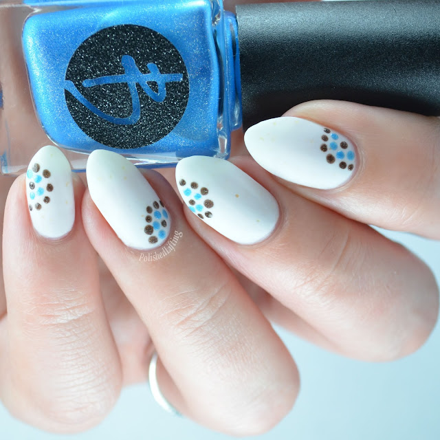 Matte white nail polish with dots