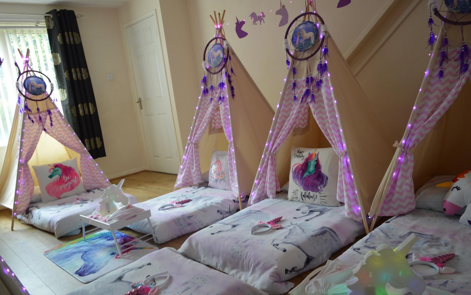 How to Host a Unicorn Birthday Party - glamping slumber party