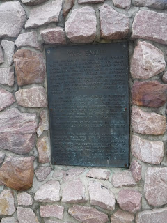 a plaque about chief War Eagle is mounted on a stone monument at War Eagle Park in Sioux City, Iowa.