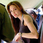 "Angelina Jolie talked about her mysterious tattoo in her latest interview in US TV Show ""Extra"""