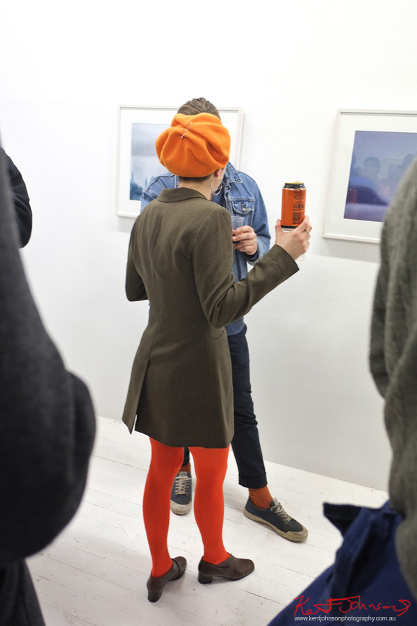 orange felt hat, tights, olive winter jacket, same orange beer can in hand. Photography by Kent Johnson for Street Fashion Sydney.