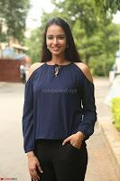 Poojita Super Cute Smile in Blue Top black Trousers at Darsakudu press meet ~ Celebrities Galleries 053.JPG