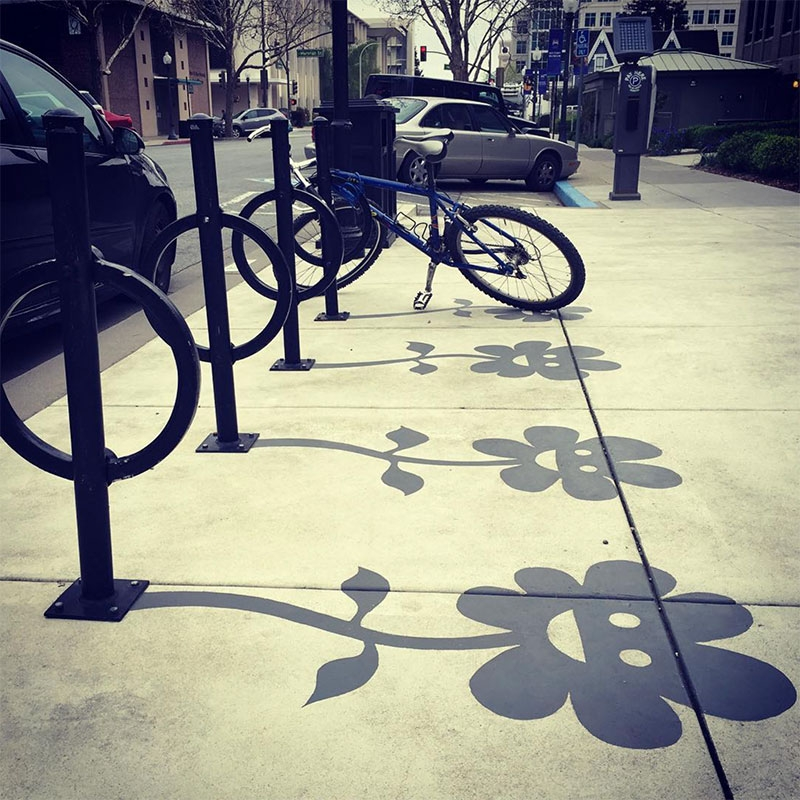 01-Bicycle-Rack-Damon-Belanger-Inventive-Surreal-Shadow-Paintings-come-Alive-www-designstack-co