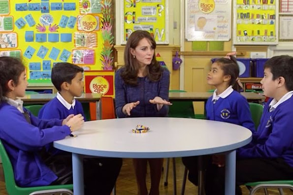Catherine, Duchess of Cambridge poses for a photo with Nimra, 10, Ryan, 10, Bailey-Rae ,7, and Connor, 11, from Salusbury Primary School in Queen's Park, London, during filming of a video message for Children's Mental Health week.