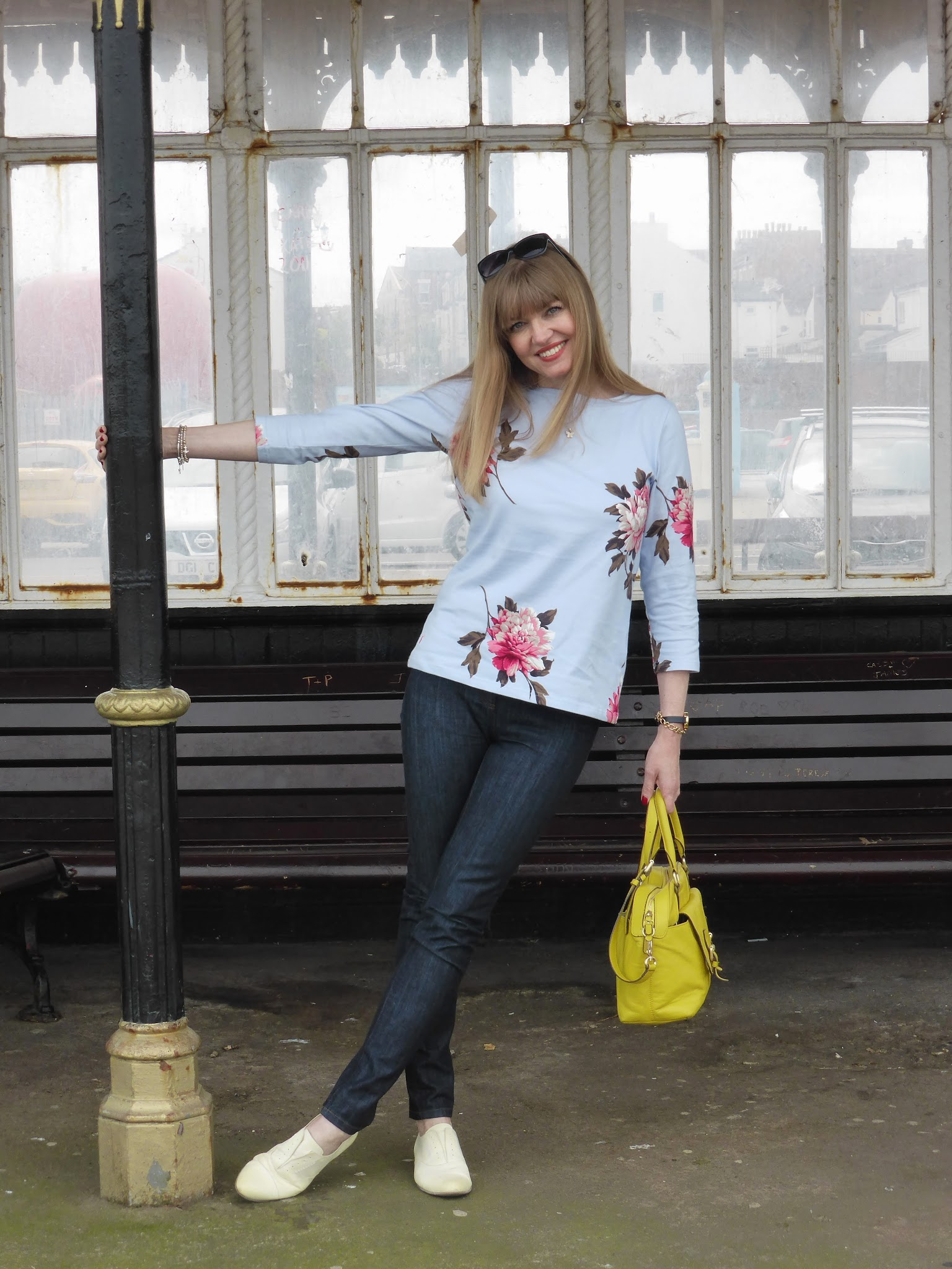 What Lizzy loves over 40 fashion blogger wearing lemon yellow brogues with skinny jeans, floral top and yellow Boden handbag