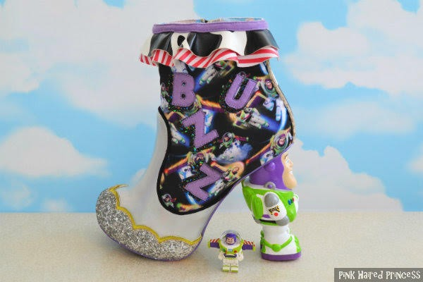 buzz lightyear ankle boot with small buzz toy figure and sky background