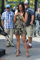 Priyanka Chopra looks super cute in happy mood wearing a short flower print dress in Hollywood 012.jpg