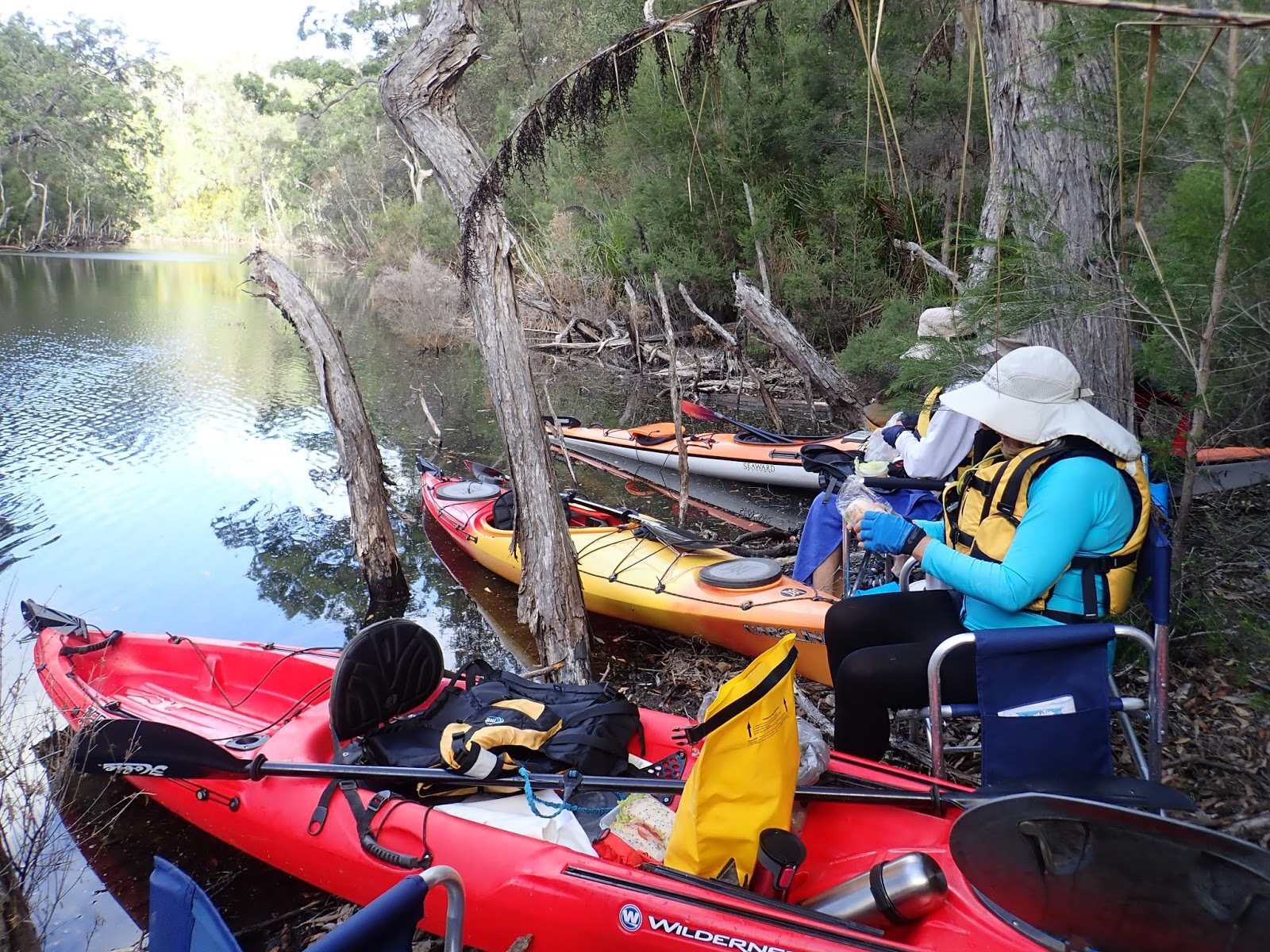 embarking once more and all on the water at 1 25pm l takes time to show s r where we were on the betka river s r had map envy having