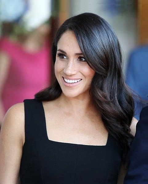 Meghan Markle wore a bespoke black sleeveless dress by Emilia Wickstead, and Deneuve shoes by Aquazzura. She carried a black satin clutch by Givenchy