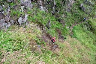 Going down, slippery rock, Trekking mount Rinjani Indonesia
