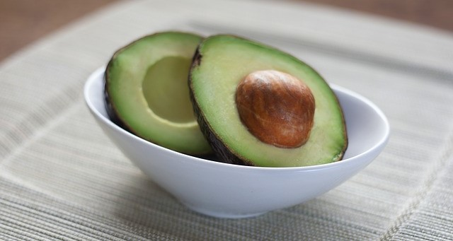 Avocado, Cut Open, Sitting in a White Bowl