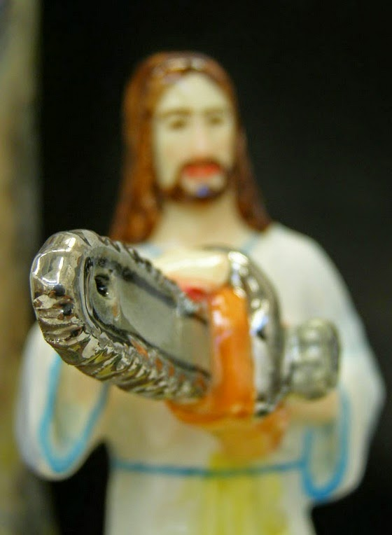 Funny Weird Jesus Collection - Chain saw statue picture