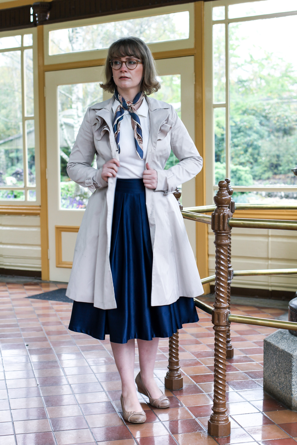 Liana of @findingfemme wears navy midi skirt from Review Australia, trench and necktie in Ballarat