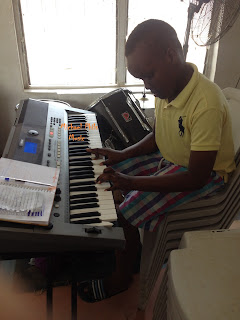 young fat boy practicing changing lives by frank edwards on the piano
