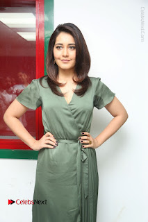 Actress Raashi Khanna Stills in Green Short Dress at Mirchi 95 Suno Aur Mercedes Jeeto Contest  0084.JPG