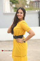 Actress Poojitha Stills in Yellow Short Dress at Darshakudu Movie Teaser Launch .COM 0323.JPG