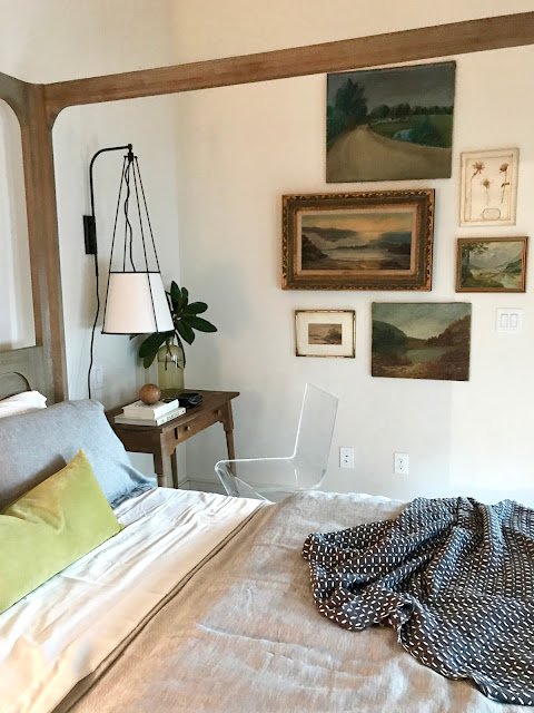 A gorgeous bedroom with Restoration Hardware bed and a charming vintage gallery of art on the wall. Design: Julie Holloway. Photo: Sherry Hart. #bedroomdcor #restorationhardware #modernrustic #rusticmodern #rusticbedroom #interiordesign