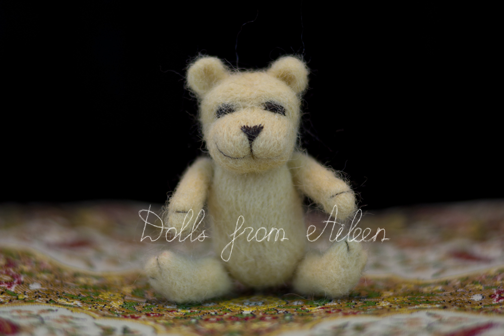 OOAK mini needle felted teddy bear sitting on carpet