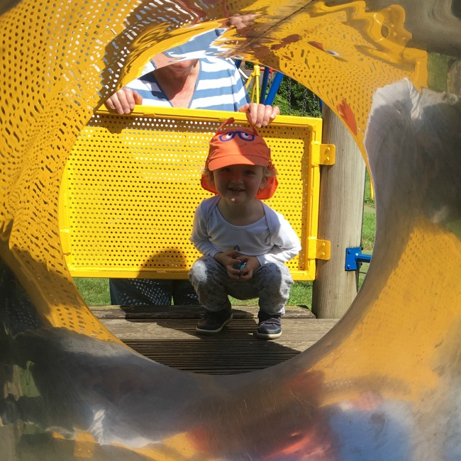 toddler-looking-through-tunnel