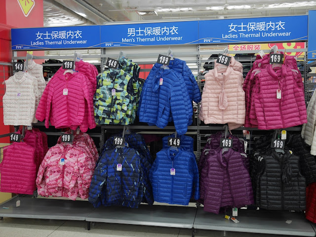 "jackets on display under ""thermal underwear"" signs at a Walmart in Zhongshan"