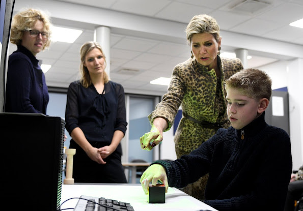 Queen Máxima visits Roessing Research and Development Centre in Enschede. Queen Maxima wore Natan Leopard Dress