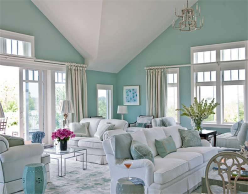 white slipcover sofas in aqua coastal room