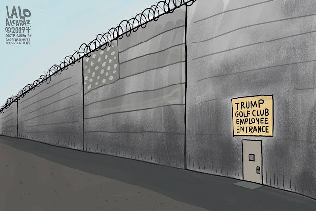 Picture of Donald Trump's border wall with a door in it labeled