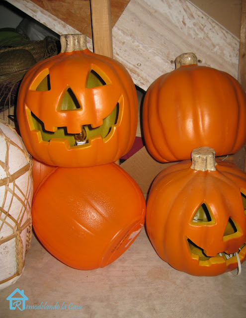 plastic jack-o-lanterns transformed with fabric and Mod-Podge