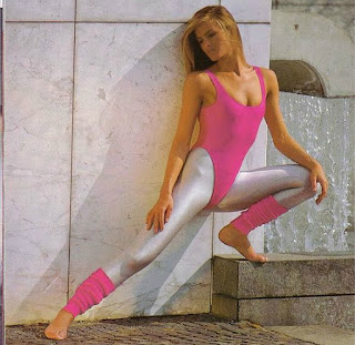 80s Workout Girl wearing pink leotard, leg warmers