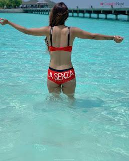 Neha Malik in Red Bikini Beautiful Actress Model Sizzling Spicy Bikini Pics .XYZ Exclusive 16