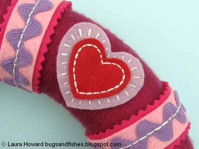 glue the felt hearts in place