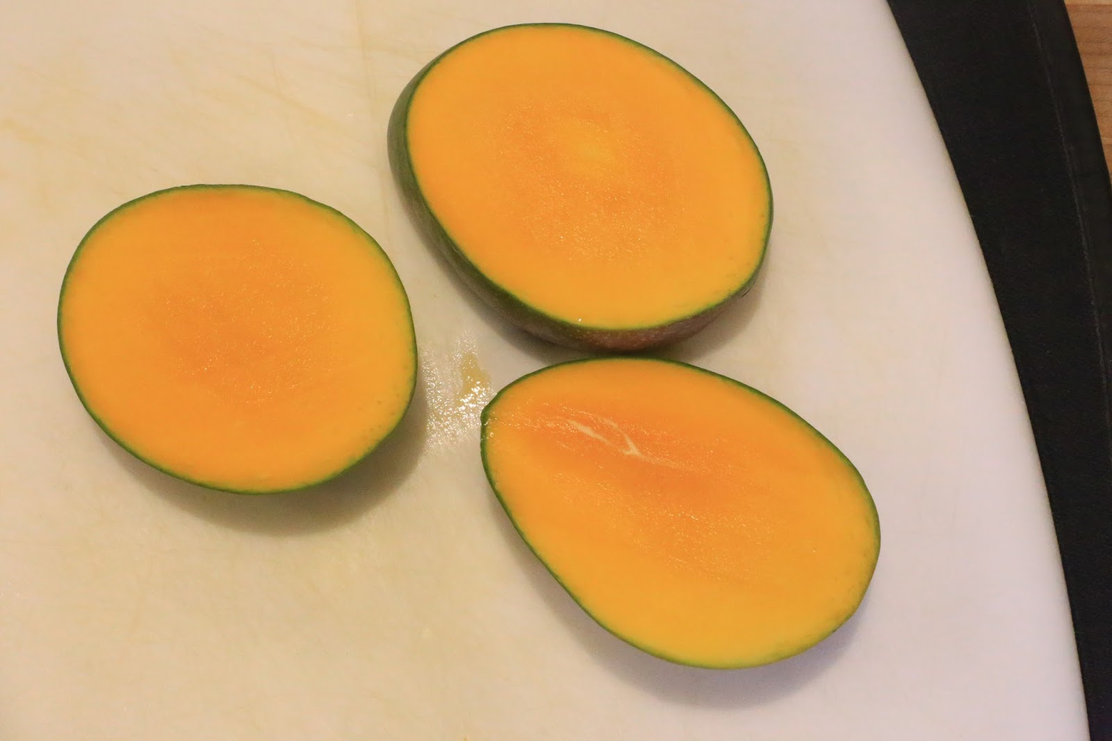 The Mango Has A Flatish Oblong Pit In The Center Of It Hold The Mango  With One Hand, Standing It On Its End With The Stem Side Down And Beginning  At The