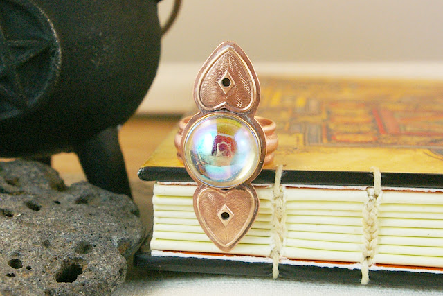 https://www.etsy.com/ca/listing/686135221/long-vintage-czech-glass-ab-aura-orb-and