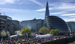 Pic of the large crowd and market stalls in front of City Hall, London