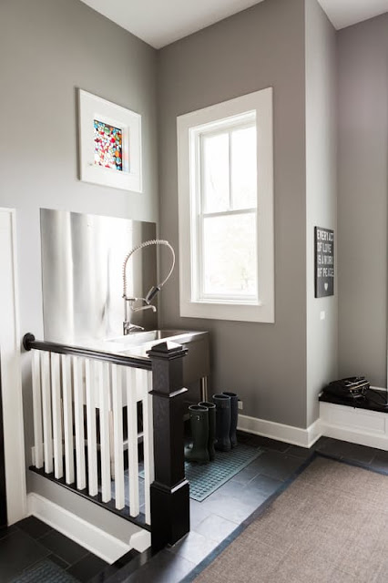 Mudroom with stainless sink in modern farmhouse - Hello Lovely Studio