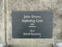 "Sign that identifies the sculpture. John Simms ""Imploding Cube"""