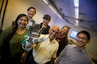 A research team at UC San Diego and Rady Children's Hospital has developed a sensor-filled glove to accurately measure muscle stiffness. Credit: Erik Jepsen/UC San Diego Publications
