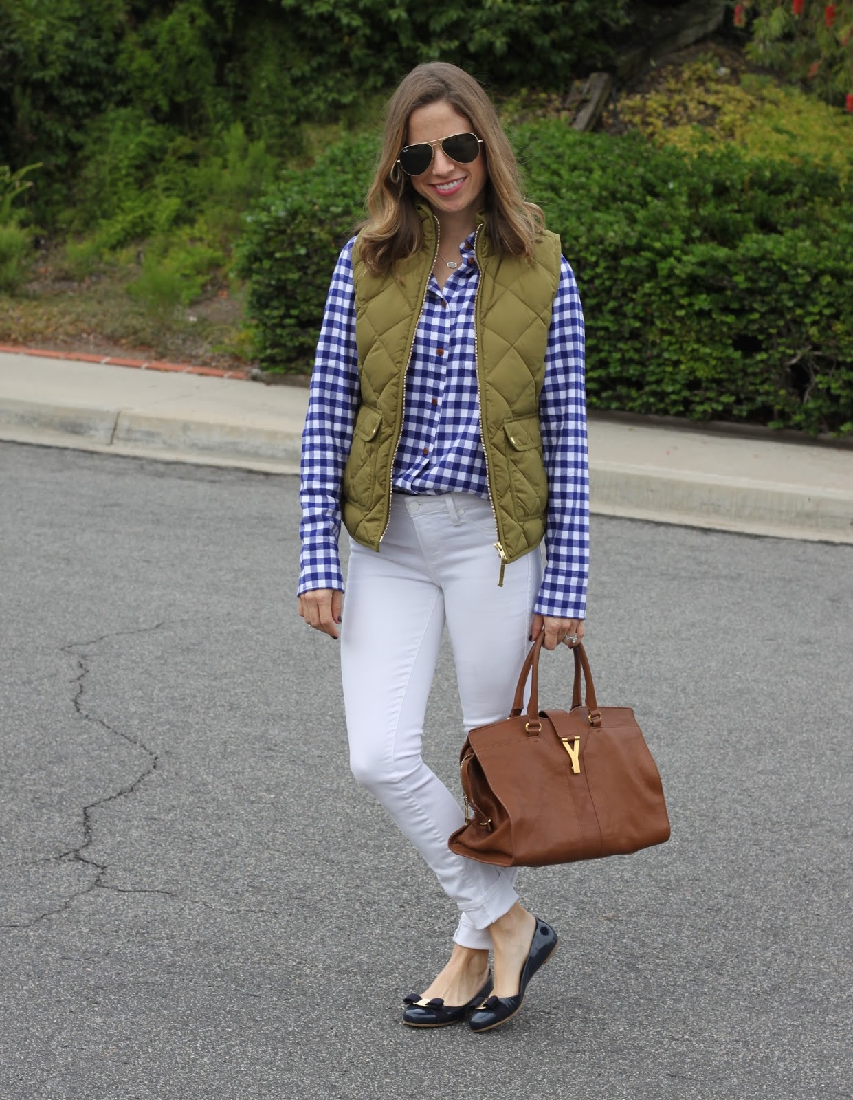vest and white jeans