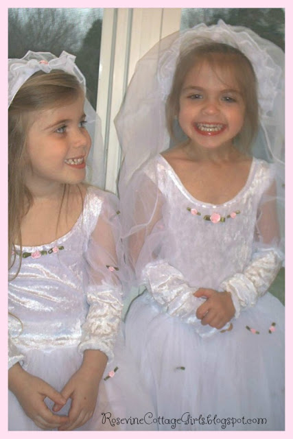 A Mary Heart In A Martha World | Two little girls playing dress up in little wedding dresses | @ Rosevine Cottage Girls | RosevineCottageGirls.com