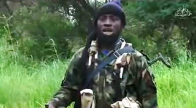 Boko Haram's shadowy leader Abubakar Shekau is shown in an August 8, 2016 video released by the Nigerian Islamist extremist group. By (BOKO HARAM/AFP/HO/File) Lagos (AFP) - Nigeria's military claimed Tuesday to have seriously injured Boko Haram's elusive leader Abubakar Shekau and killed other commanders in an air strike on the Islamist group's forest stronghold.
