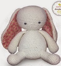 http://www.ravelry.com/patterns/library/bunny-rabbit-with-pom-pom-butt